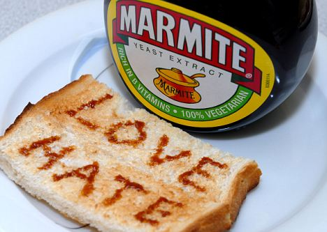 Generic image of Marmite with Love and Hate written on toast.  A Unilever Brand guaranteed to cause arguments. Image shot 03/2010. Exact date unknown.